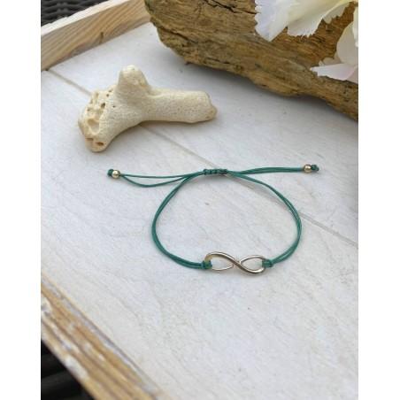 Bracelet cordon vert et infini métal