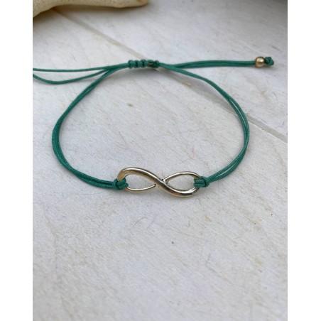 Bracelet symbole infini et cordon vert