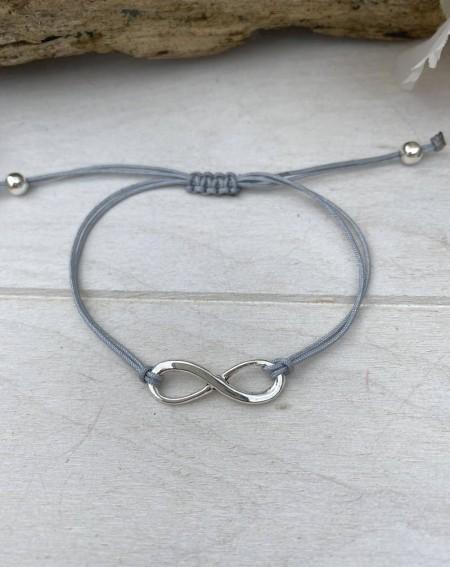 Bracelet symbole infini et cordon ajustable gris