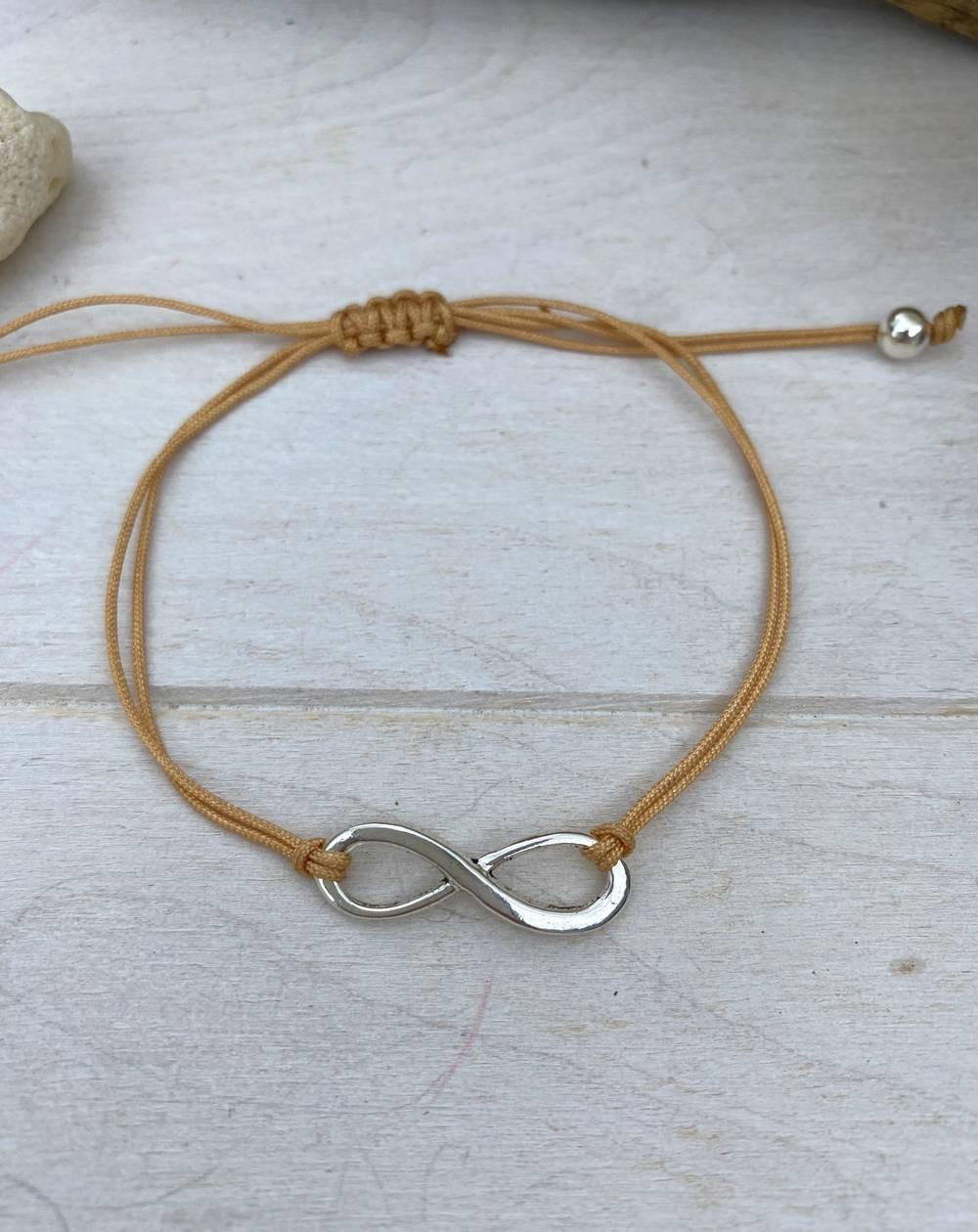 Bracelet cordon marron au sigle infini