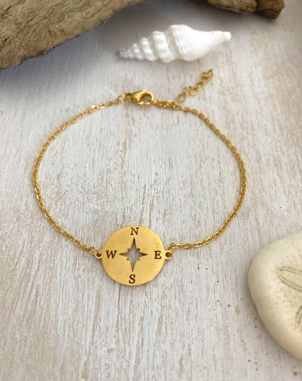 Bracelet fin rose des vents en acier doré