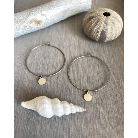 Boucle d'oreilles créoles au médaillon en acier argenté