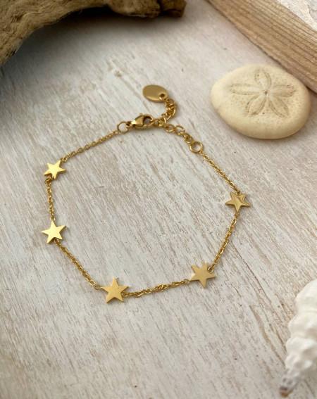 Bracelet aux étoiles coloris doré en acier hypoallergénique