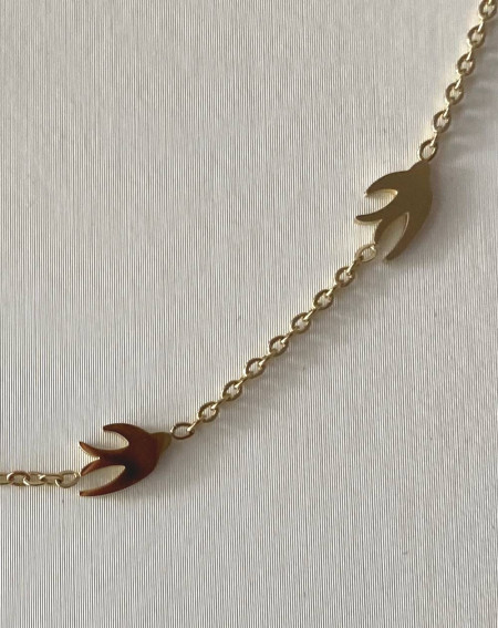 Collier hirondelles dorées en acier inoxydable