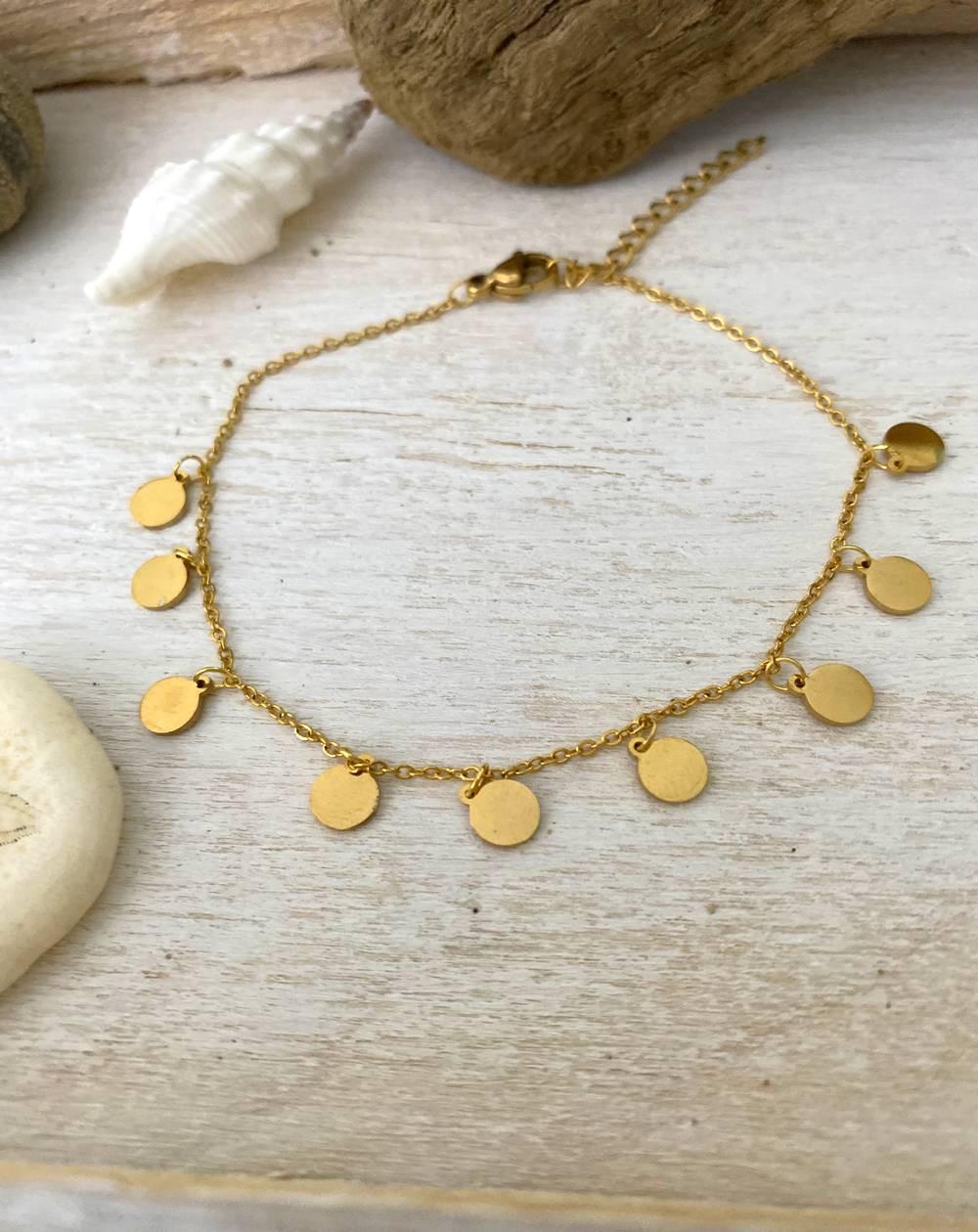 Bracelet aux 9 médaillons coloris doré en acier inoxydable
