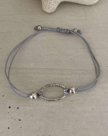 Bracelet original avec un anneau ovale et cordon gris