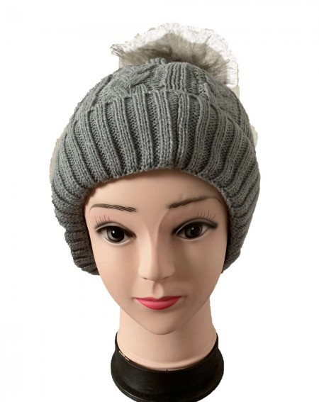 Bonnet femme à pompon coloris gris